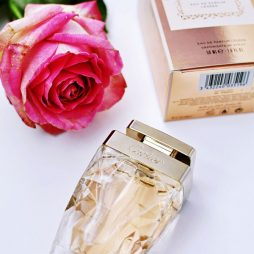 Cartier perfume and roses